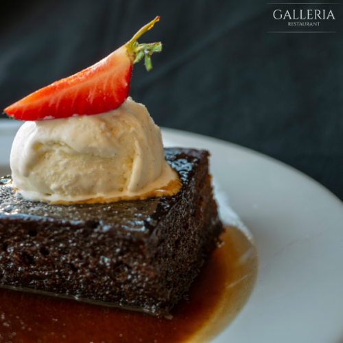 Homemade sticky toffee pudding served with toffee sauce & vanilla ice cream (V)