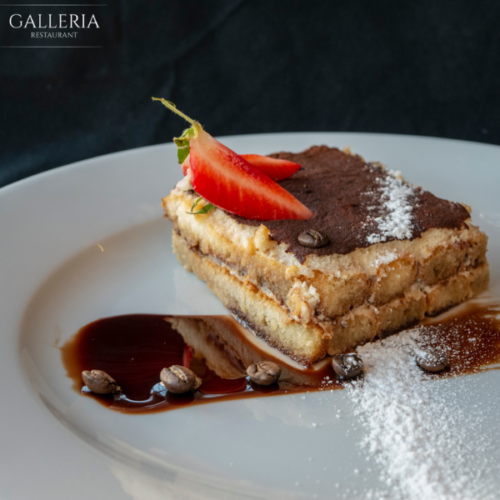 Homemade tiramisu served with chocolate sauce