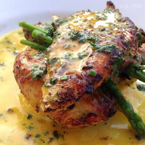 Lemon & herb chicken breast served with dauphinoise potatoes & asparagus with a herb butter sauce